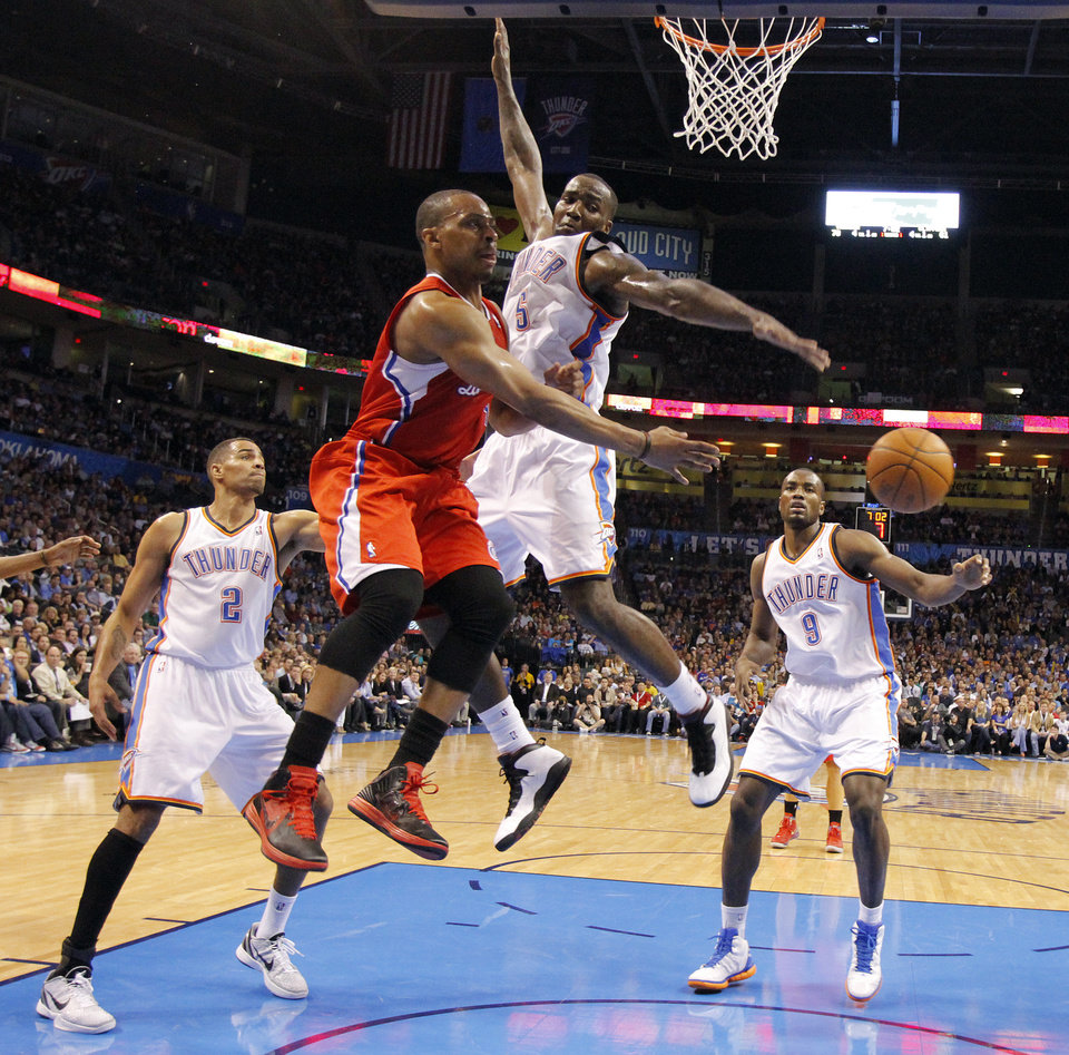 Photo - Oklahoma City Thunder center Kendrick Perkins (5) defends on Los Angeles Clippers guard Randy Foye (4) during the NBA basketball game between the Oklahoma City Thunder and the Los Angeles Clippers at Chesapeake Energy Arena on Wednesday, March 21, 2012 in Oklahoma City, Okla.  Photo by Chris Landsberger, The Oklahoman