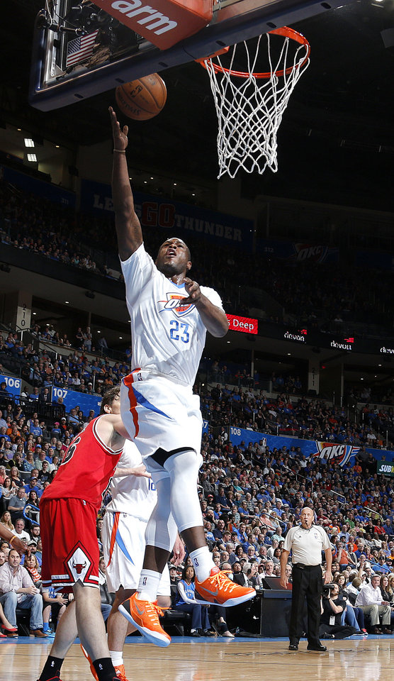 Photo - Oklahoma City's Dion Waiters (23) makes a lay up during the NBA game between the Oklahoma City Thunder and the Chicago Bulls at Chesapeake Energy Arena in Oklahoma City, Sunday, March  15, 2015. Photo by Sarah Phipps, The Oklahoman