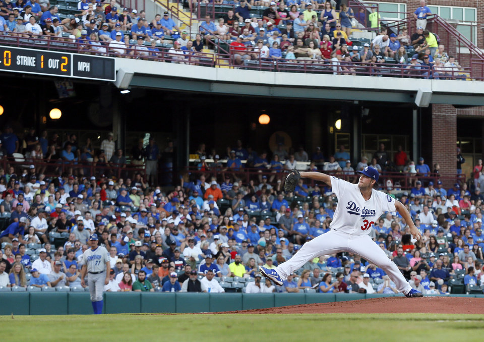 Photo - Clayton Kershaw pitches for Oklahoma City during a Triple-A baseball game between the Oklahoma City Dodgers and the Omaha Storm Chasers at the Chickasaw Bricktown Ballpark in Oklahoma City, Saturday, Aug. 26, 2017. The Los Angeles pitcher was on a rehab assignment in Oklahoma City. Photo by Nate Billings, The Oklahoman