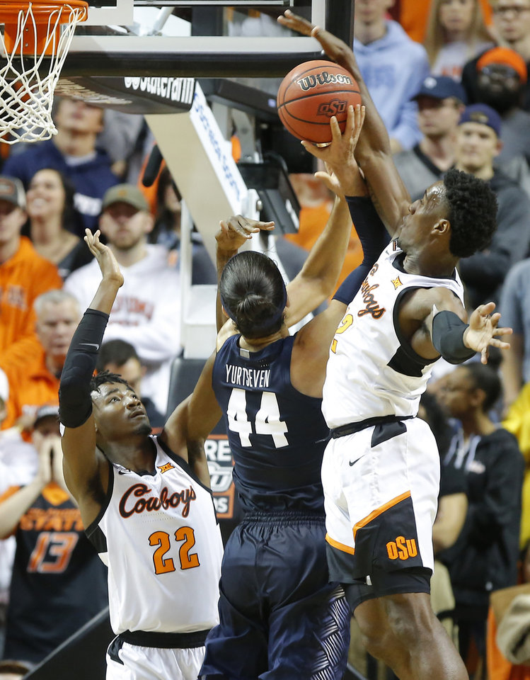 Photo - Oklahoma State's Cameron McGriff (12) blocks the shot of Georgetown's Omer Yurtseven (44) as Kalib Boone (22) defends during a college basketball game between the Oklahoma State University Cowboys (OSU) and the Georgetown Hoyas at Gallagher-Iba Arena in Stillwater, Okla., Wednesday, Dec. 4, 2019. Georgetown won 84-71. [Bryan Terry/The Oklahoman]
