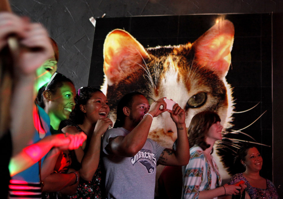 Photo -  Fans watch as Eureeka performs at Opolis during the 2012 Norman Music Festival. [Photo by Bryan Terry, The Oklahoman Archives]