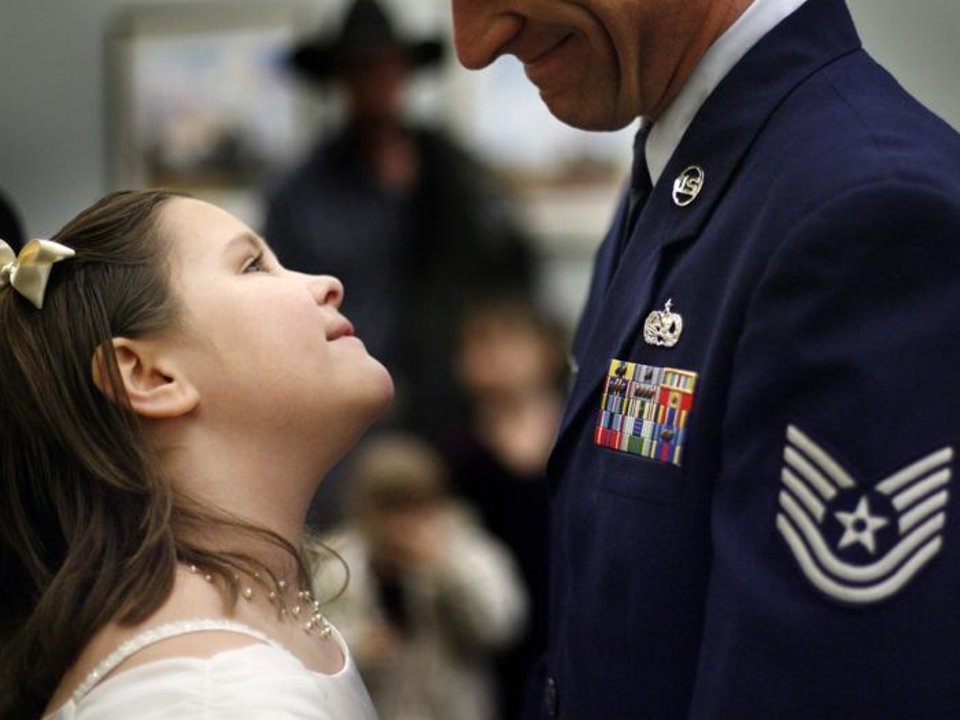 Photo -  TODD ZENZEN: Brianna Zenzen, 8, looks up at her dad Todd as they wait in line during the Daddy Daughter Dance in Midwest City, Okla., Friday, Feb. 8, 2008. BY BRYAN TERRY, THE OKLAHOMAN ORG XMIT: KOD