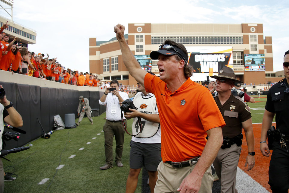 Photo - Oklahoma State coach Mike Gundy cheers towards the fans after after a college football game between the Oklahoma State University Cowboys (OSU) and the Boise State Broncos at Boone Pickens Stadium in Stillwater, Okla., Saturday, Sept. 15, 2018. Oklahoma State won 44-21. Photo by Bryan Terry, The Oklahoman