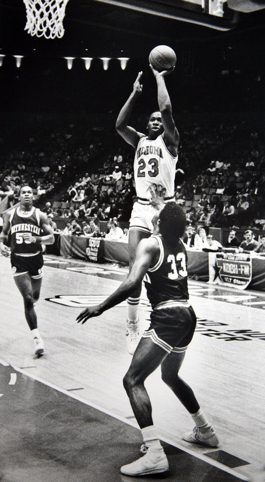 Photo - Former OU basketball player Wayman Tisdale. Record-setting shot: Wayman Tisdale pumps in the basket which made him the all-time scoring leader in the Big Eight. Staff photo by Doug Hoke. Photo taken 1/12/1985, Photo published 1/14/1985 in The Daily Oklahoman. ORG XMIT: KOD