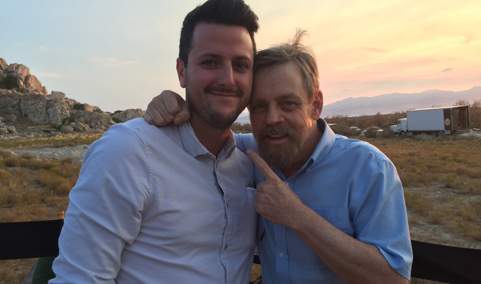 Photo -  Oklahoma's Kevin Costello, left, stands with Mark Hamill on the set of
