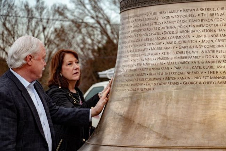 Photo -  The Rev. Bob Long, senior pastor of St. Luke's United Methodist Church, and his wife Marsha look at a bronze bell — said to be the fifth-largest largest bell in North America — that will be dedicated in a special ceremony set for Sunday at St. Luke's Edmond, 900 N Sooner Road in Edmond. [Photo provided]
