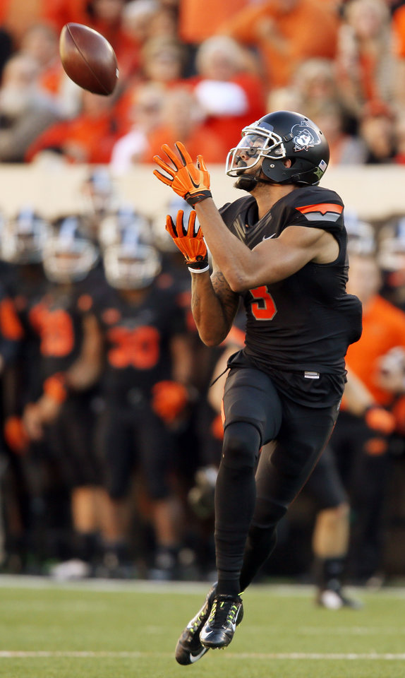 Photo - Oklahoma State's Marcell Ateman (3) makes a catch on his way to a touchdown in the second quarter during the college football game between the Oklahoma State Cowboys (OSU) and TCU Horned Frogs at Boone Pickens Stadium in Stillwater, Okla., Saturday, Nov. 7, 2015. Photo by Nate Billings, The Oklahoman