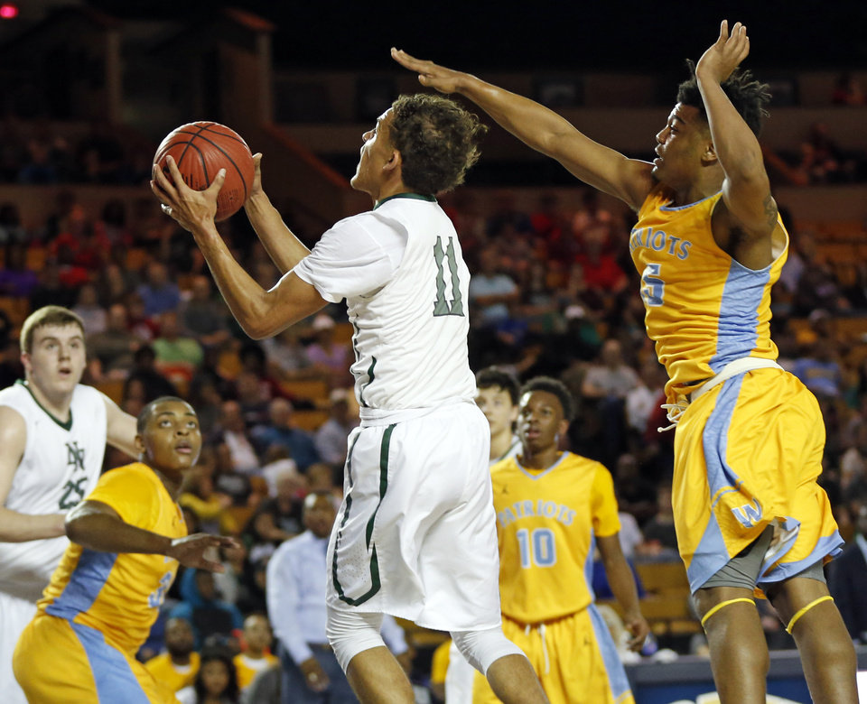 Photo - Norman North's Trae Young (11) shoots in front of Putnam City West's Payton Bradley (15) during the championship game of the Class 6A boys state basketball tournament between Norman North and Putnam City West at the Mabee Center in Tulsa, Okla., Saturday, March 12, 2016. Photo by Nate Billings, The Oklahoman
