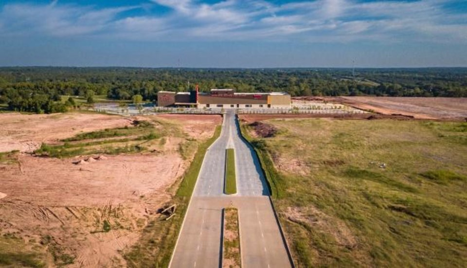 Photo -  Drone image of construction at Interstate 35 and Covell Road.[Dave Morris/The Oklahoman]
