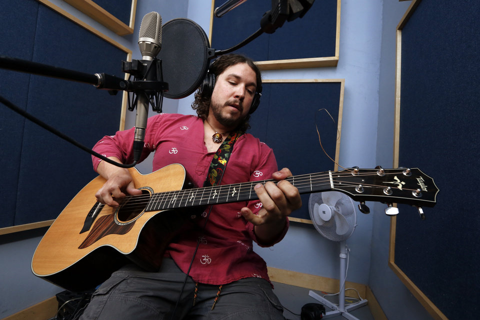 Photo -  Musician Aaron Hale works on an album at Bell Labs in Norman, Okla. [Photo by Steve Sisney]