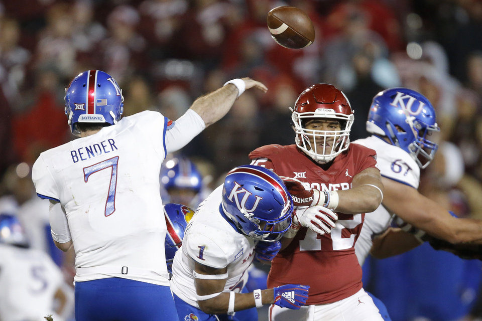 Photo - Kansas' Peyton Bender (7) throws over Oklahoma's Amani Bledsoe (72) during a college football game between the University of Oklahoma Sooners (OU) and the Kansas Jayhawks (KU) at Gaylord Family-Oklahoma Memorial Stadium in Norman, Okla., Saturday, Nov. 17, 2018. Photo by Bryan Terry, The Oklahoman