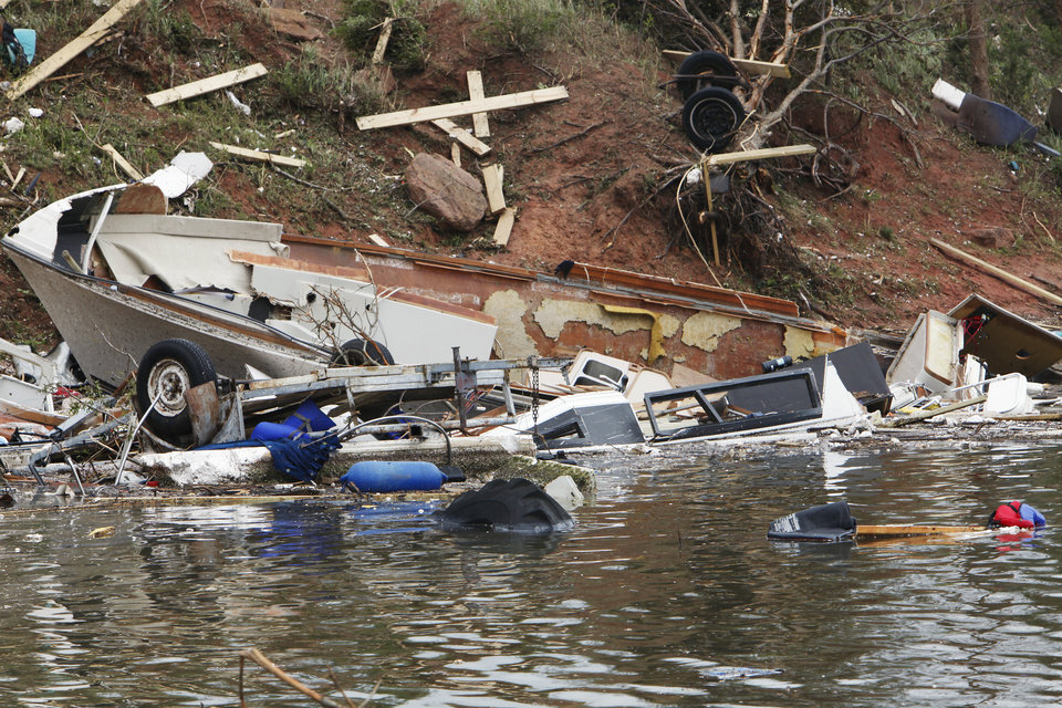 Photo - Boats damaged by the tornado at the marina at Lake Thunderbird State Park on Alameda in Norman, Tuesday, May 11, 2010. Photo by David McDaniel, The Oklahoman