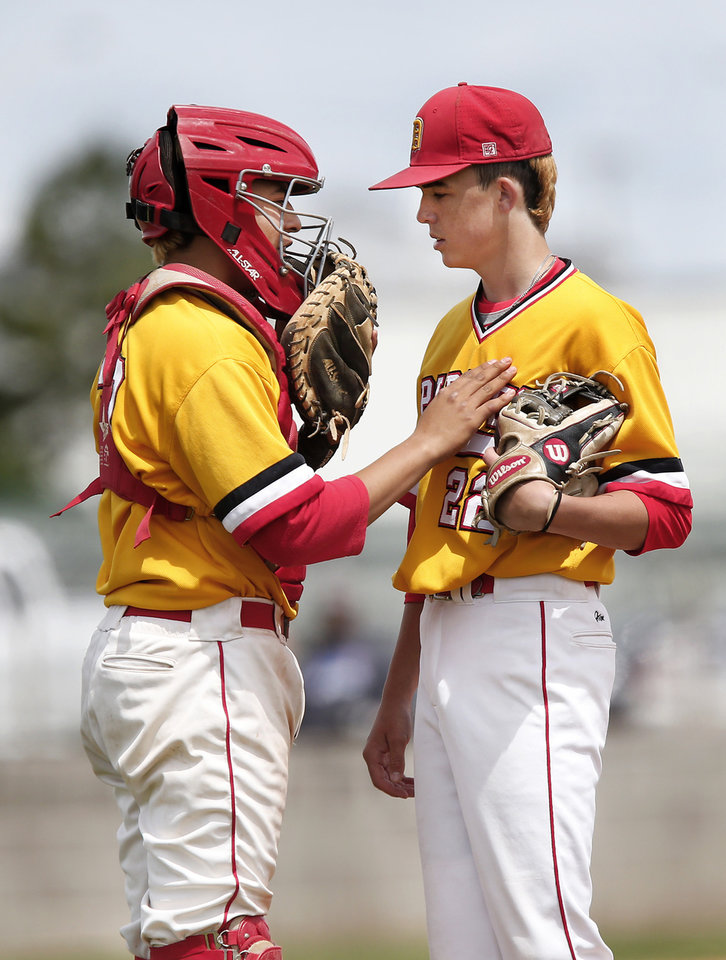 Photo - Dale catcher Jono Johnson walks to the mound to talk with his pitcher, Ryan Haynie,  during Class 2A baseball state semifinal game at Shawnee High School on Friday, May 10, 2019. Dale defeated Oktaha, 6-0.    [Jim Beckel/The Oklahoman]