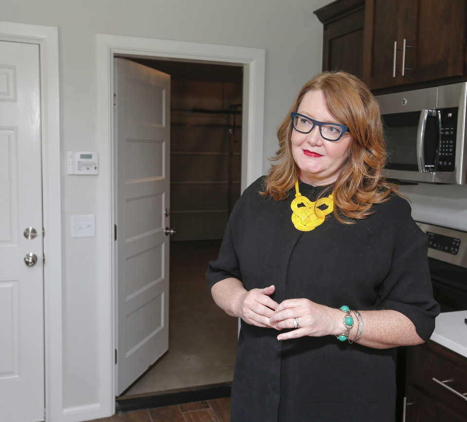 Photo -  Neila Crank-Clements, executive director of Progress OKC, talks about affordable housing redevelopment work on NE Euclid Street. [PHOTO BY NATE BILLINGS, THE OKLAHOMAN]