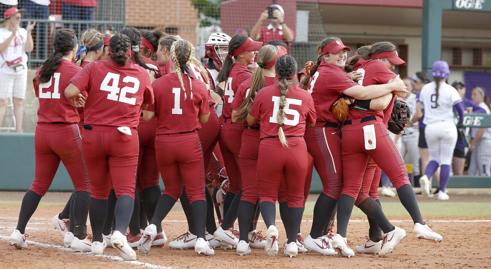 Photo - Oklahoma players celebrate after the second softball game in the Norman Super Regional between the University of Oklahoma (OU) and Northwestern in Norman, Okla., Saturday, May 25, 2019. Oklahoma won 8-0 to send them to the Women's College World Series. [Bryan Terry/The Oklahoman]