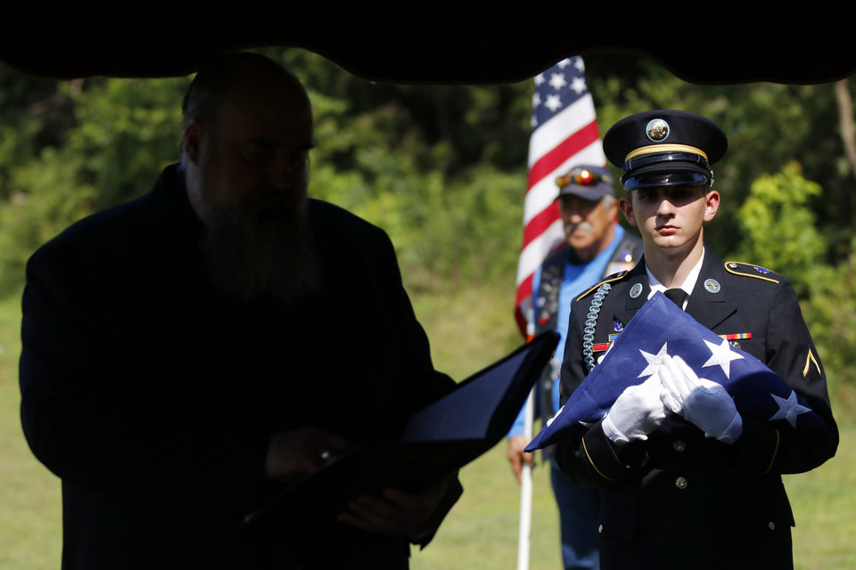 Photo - Rev. Richard Mize, Trinity Presbyterian Church speaks at the memorial for U.G. Moore, a WWI vet whose grave marker never make it to his grave at Trice Hill Cemetery, until 55 years after his death, Tuesday, July 16, 2019. [Doug Hoke/The Oklahoman]