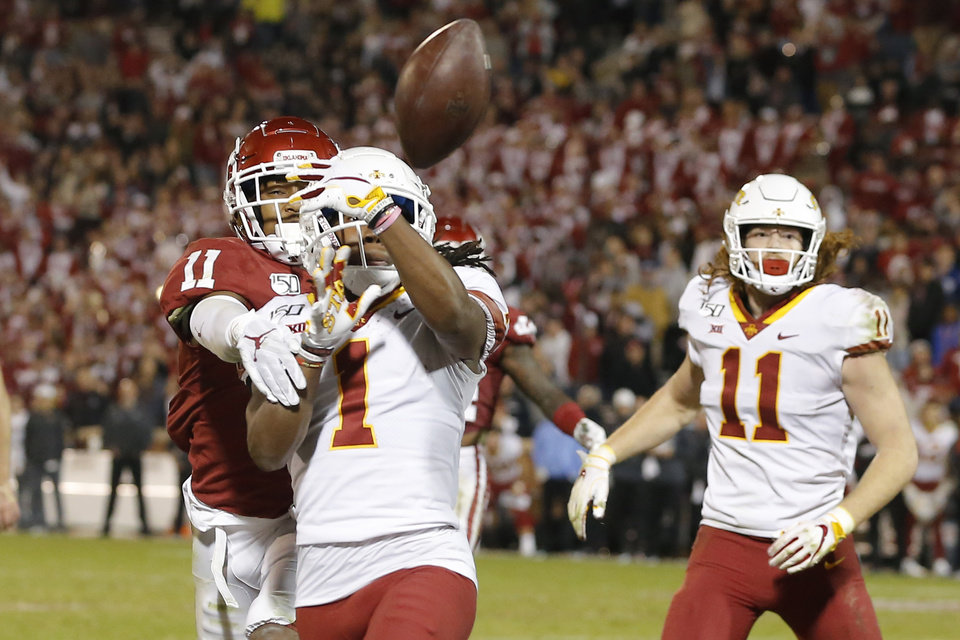 Photo - Oklahoma's Parnell Motley (11) breaks up a pass in the end zone intended for Iowa State's Tarique Milton (1) during an NCAA football game between the University of Oklahoma Sooners (OU) and the Iowa State University Cyclones at Gaylord Family-Oklahoma Memorial Stadium in Norman, Okla., Saturday, Nov. 9, 2019. [Bryan Terry/The Oklahoman]