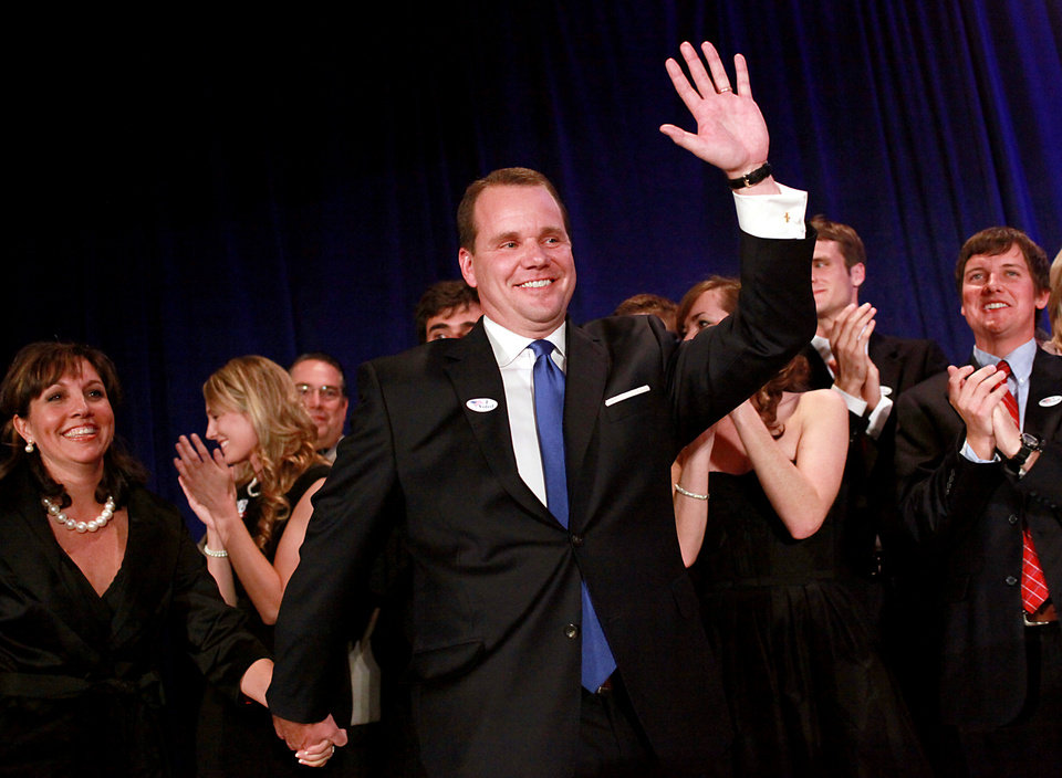 Photo - Todd Lamb, with his wife Monica (left) wave to supporters during the Republican Watch Party at the Marriott in Oklahoma City on Tuesday, Nov. 2, 2010.Photo by John Clanton, The Oklahoman