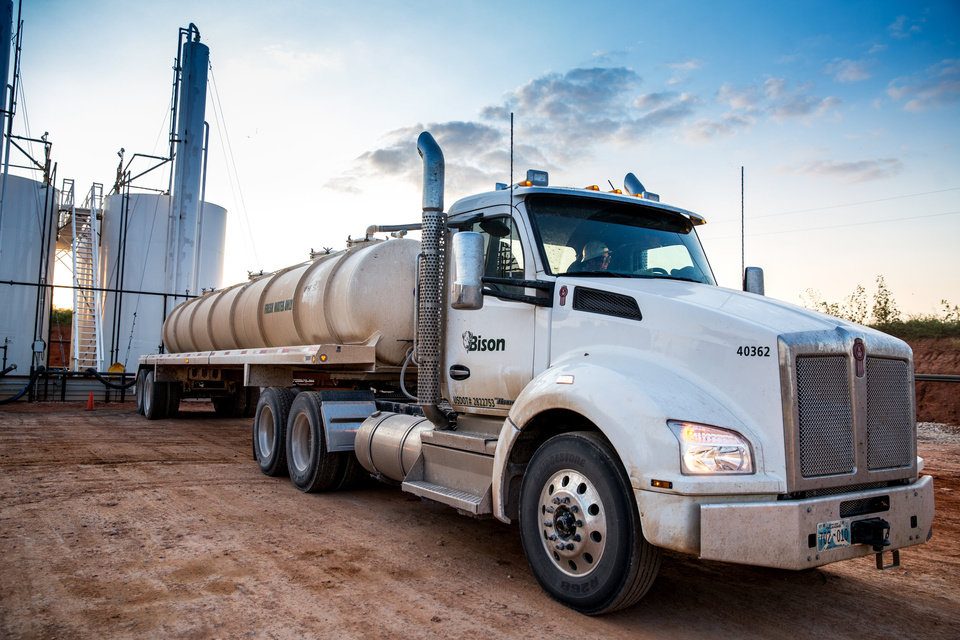 Photo -  A Bison Oilfield Services truck is shown in this picture. Bison, an operator in the SCOOP, Merge and STACK plays, is in the process of building a permanent network of pipes to carry produced water to disposal wells. [PHOTO PROVIDED]