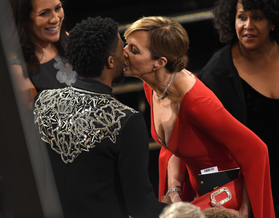 Photo - Chadwick Boseman, left, greets Allison Janney in the audience at the Oscars on Sunday, March 4, 2018, at the Dolby Theatre in Los Angeles. (Photo by Chris Pizzello/Invision/AP)