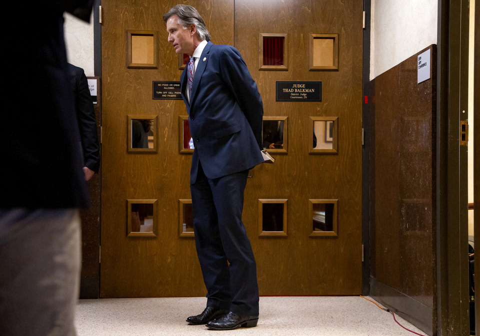 Photo - Attorney General Mike Hunter stands outside Judge Thad Balkman's courtroom after the hearing to settle the Journal Entry of Judgment for opioid trial at the Cleveland County Courthouse in Norman, Okla. on Tuesday, Oct. 15, 2019. Judge Balkman ruled last Aug. in favor of the State of Oklahoma, for Johnson and Johnson pay $572 million to a plan to abate the opioid crisis.  [Chris Landsberger/The Oklahoman]