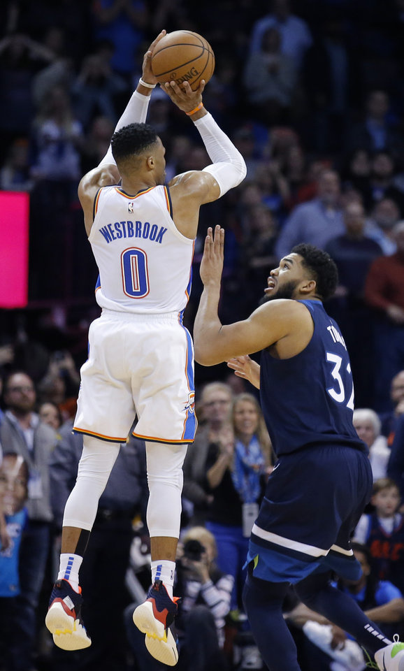 Photo - Oklahoma City's Russell Westbrook (0) misses a last second shot as Minnesota's Karl-Anthony Towns (32) defends during the NBA game between the Oklahoma City Thunder and Minnesota Timberwolves at the Chesapeake Energy Arena, Tuesday, Jan. 8, 2019. Photo by Sarah Phipps, The Oklahoman