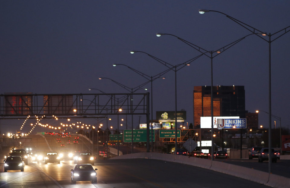 Photo - OG&E maintains around 34,000 streetlights and highway lights around Oklahoma City. Utility officials told the city council Tuesday that the city is charged the electric bill for every light, working or not, and many are out of order. [Photo by Doug Hoke, The Oklahoman]