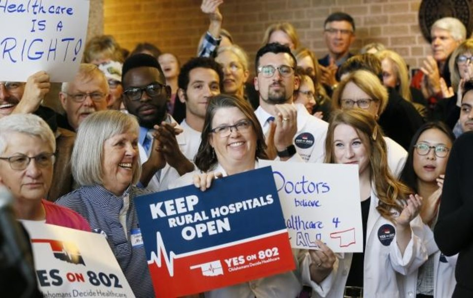 Photo -  Supporters of Medicaid expansion cheer and applaud before they delivered petitions for state question 802 to the Oklahoma Secretary of State's office in Oklahoma City, Thursday, Oct. 24, 2019. [Nate Billings/The Oklahoman]