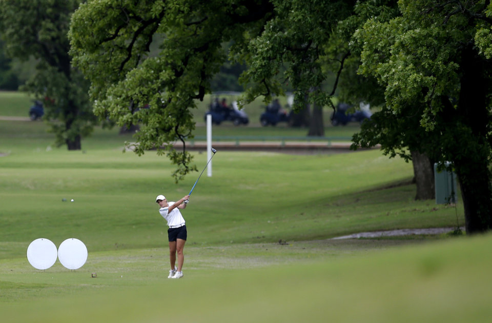 Photo - McGuinness' Taylor Due tees off the16th hole during the 5A girls golf state tournament at Lincoln Park West in Oklahoma City, Wednesday, May 1, 2019. [Sarah Phipps/The Oklahoman]