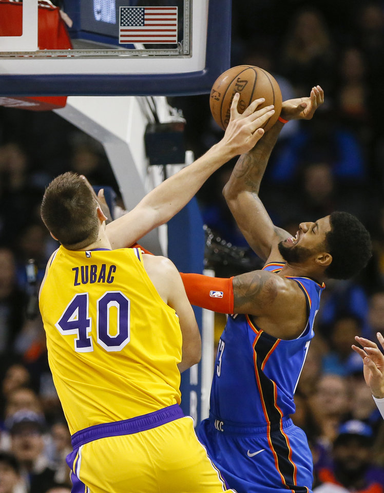 Photo - Los Angeles' Ivica Zubac (40) fouls Oklahoma City's Paul George (13) in the fourth quarter during an NBA basketball game between the Los Angeles Lakers and the Oklahoma City Thunder at Chesapeake Energy Arena in Oklahoma City, Thursday, Jan. 17, 2019. Los Angeles won 128-138 in overtime. Photo by Nate Billings, The Oklahoman