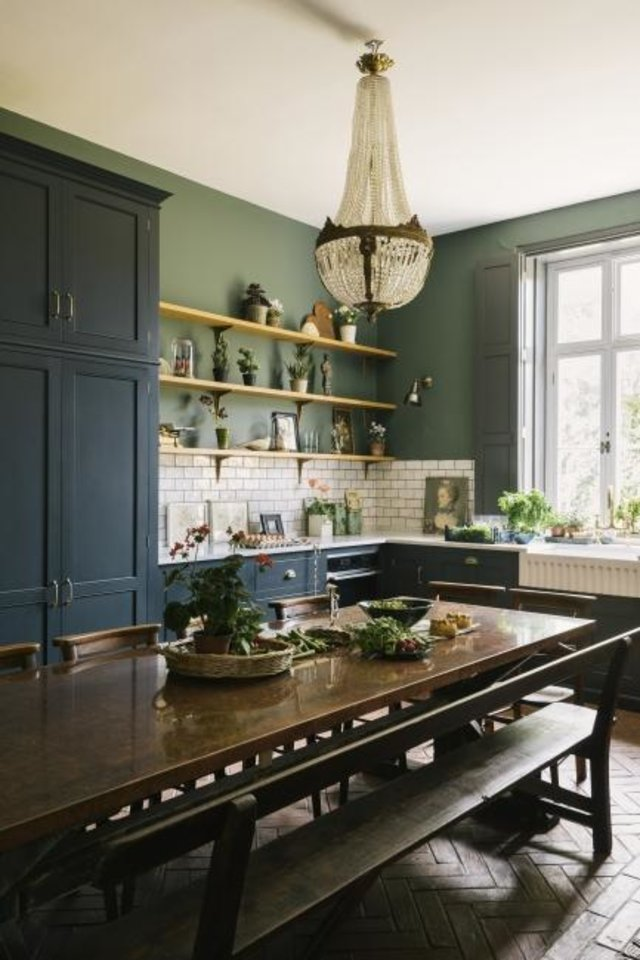 Photo -  A deVOL kitchen in a Victorian rectory features a handmade, copper-topped table as its centerpiece. DeVOL kitchens start at $40,000. [deVOL]
