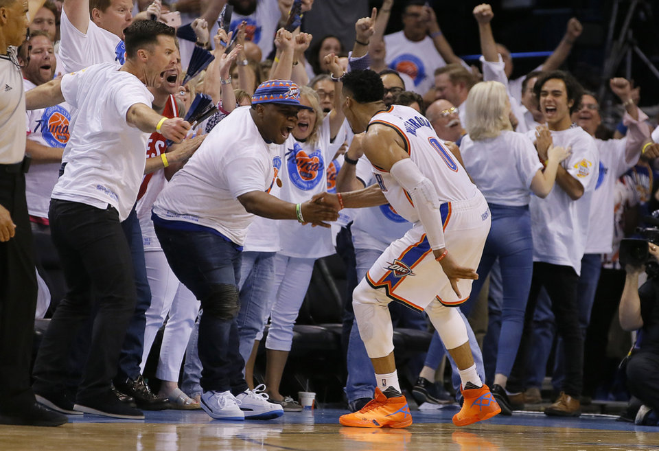 Photo - Oklahoma City's Russell Westbrook (0) looks slaps hands with his brother Ray Westbrook after making a shot during Game 4 of the Western Conference finals in the NBA playoffs between the Oklahoma City Thunder and the Golden State Warriors at Chesapeake Energy Arena in Oklahoma City, Tuesday, May 24, 2016. Oklahoma City won 118-94.  Photo by Bryan Terry, The Oklahoman
