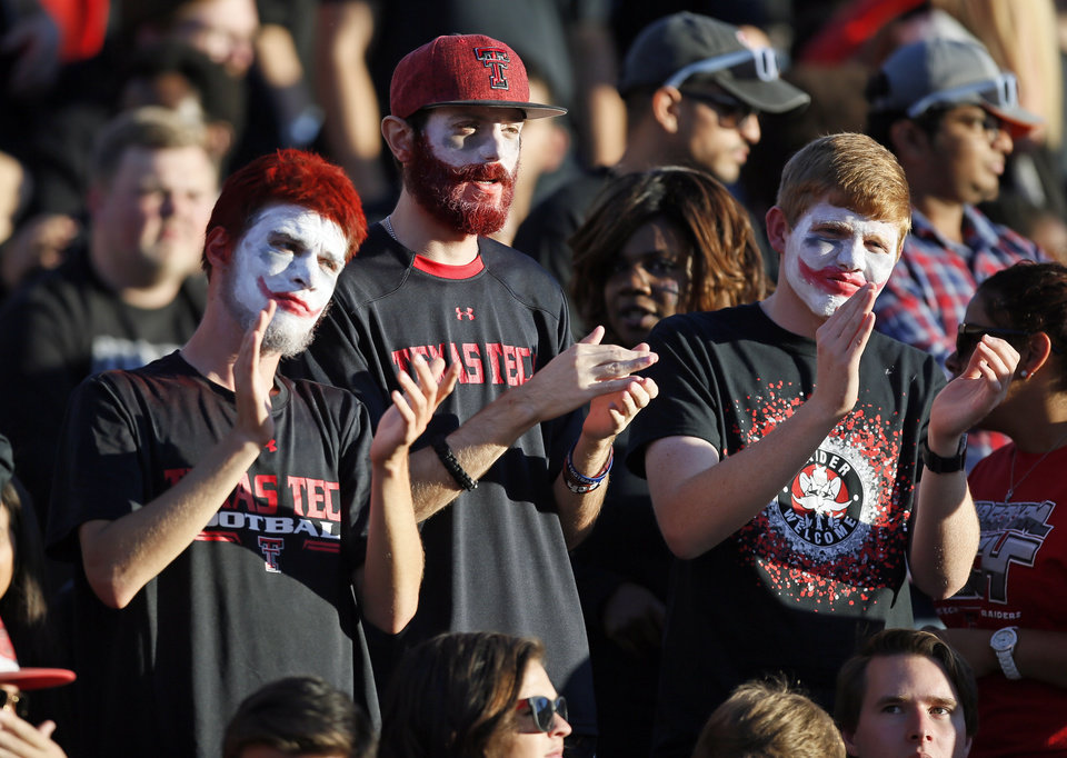Photo - Texas Tech fans applaud before a college football game between the University of Oklahoma Sooners and Texas Tech Red Raiders at Jones AT&T Stadium in Lubbock, Texas, Saturday, Oct. 22, 2016. Photo by Nate Billings, The Oklahoman