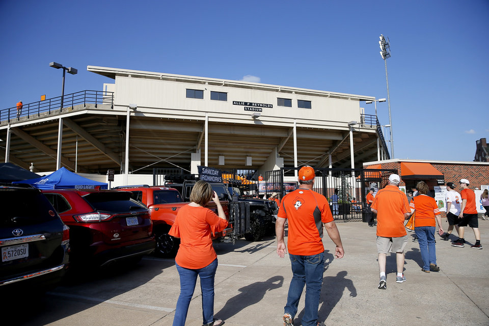 Photo - Fans walk to Allie P. Reynolds Stadium before the final scheduled baseball series at the stadium between Oklahoma State and Baylor in Stillwater, Okla., Thursday, May 16, 2019.  [Bryan Terry/The Oklahoman]
