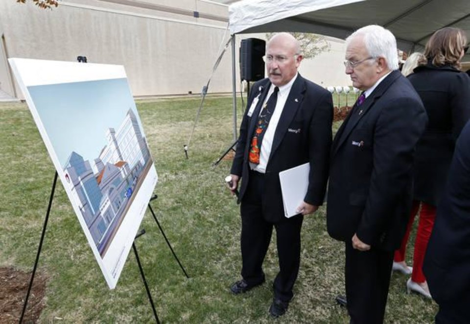 Photo -  Mercy chaplains John Teague and Richard Thibodeau look at artist renderings Tuesday at the blessing and groundbreaking of the Oklahoma Heart Hospital and Mercy Hospital South expansion. [Photo by Steve Sisney, The Oklahoman]