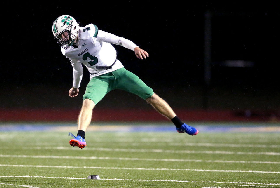 Photo - Bishop McGuinness's Zach Schmit follows through after a kick off during the high school football game between Piedmont and Bishop McGuinness at Piedmont High School in Piedmont, Okla.,  Friday, Oct. 25, 2019. [Sarah Phipps/The Oklahoman]
