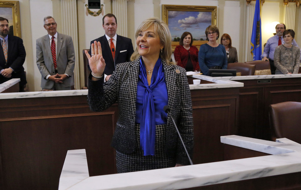 Photo - Gov. Mary Fallin waves to those gathered in the gallery as the Oklahoma Legislature host the 2016 State-of-the-State Address by Gov. Mary Fallin in the chamber of the House of Representatives at the Oklahoma state capitol on Monday, Feb. 1, 2016, in Oklahoma City, Okla. Photo by Jim Beckel, The Oklahoman