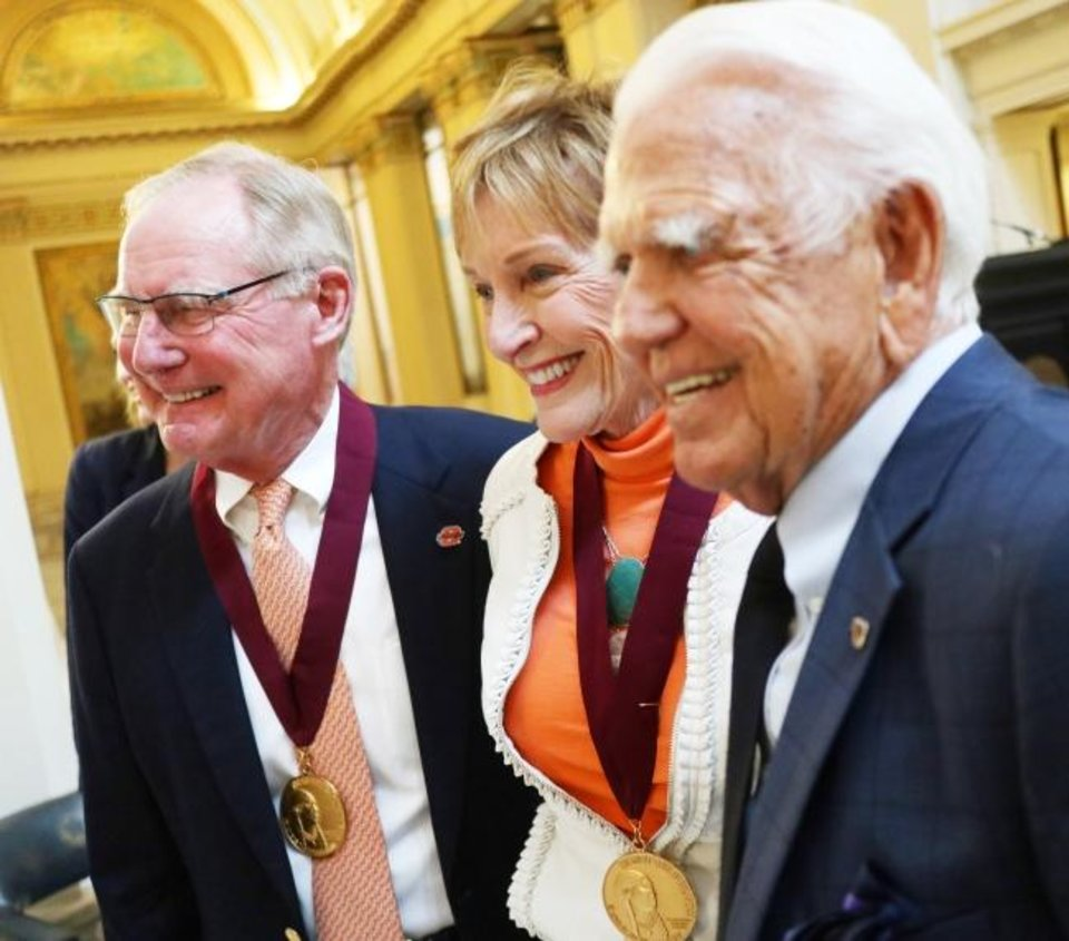 Photo -  Oklahoma State University President Burns Hargis and his wife, Ann, pose with former Gov. George Nigh at the Governor's Arts Awards at the Capitol, Tuesday, April 16, 2019. The Hargises received the George Nigh Public Service in the Arts Award at the ceremony. [Photo by Doug Hoke/The Oklahoman]