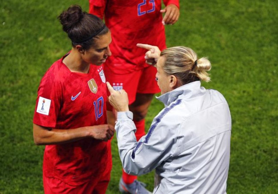 Photo -  United States coach Jill Ellis gestures as she talks to Carli Lloyd during a 13-0 rout of Thailand on Tuesday in Reims, France. [AP Photo/Francois Mori]