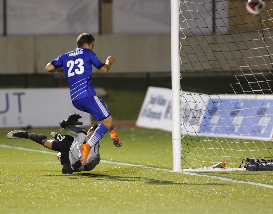 Photo - FC Edmonton's Jake Keegan (23) ties the game with a goal during a North American Soccer League game between Rayo OKC and FC Edmonton in Yukon, Okla., Saturday, July 2, 2016. The game ended in a 1-1 tie. Photo by Kurt Steiss, The Oklahoman