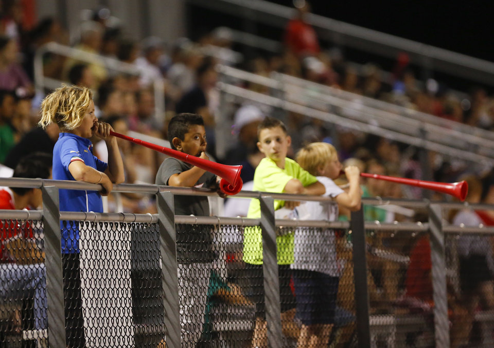 Photo - Young fans blow vuvuzelas during a North American Soccer League game between Rayo OKC and FC Edmonton in Yukon, Okla., Saturday, July 2, 2016. The game ended in a 1-1 tie. Photo by Kurt Steiss, The Oklahoman