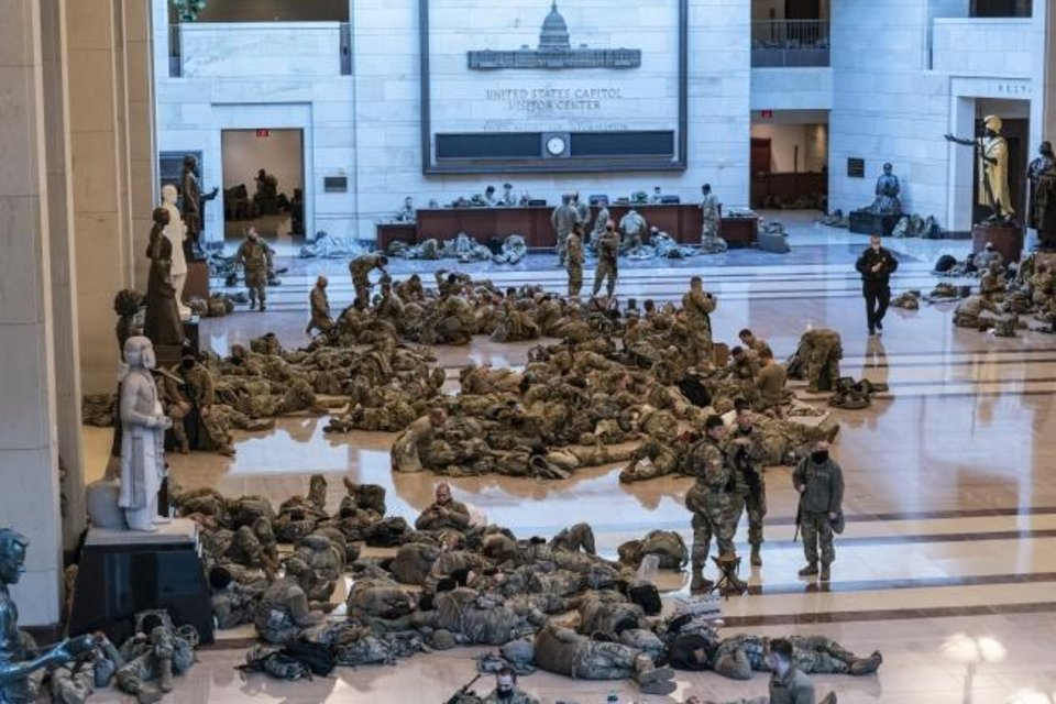 Photo -  Hundreds of National Guard troops hold inside the Capitol Visitor's Center to reinforce security at the Capitol in Washington on Wednesday. The Oklahoma National Guard will be sending 400 members to assist with security for next week's inauguration. [AP Photo/J. Scott Applewhite]