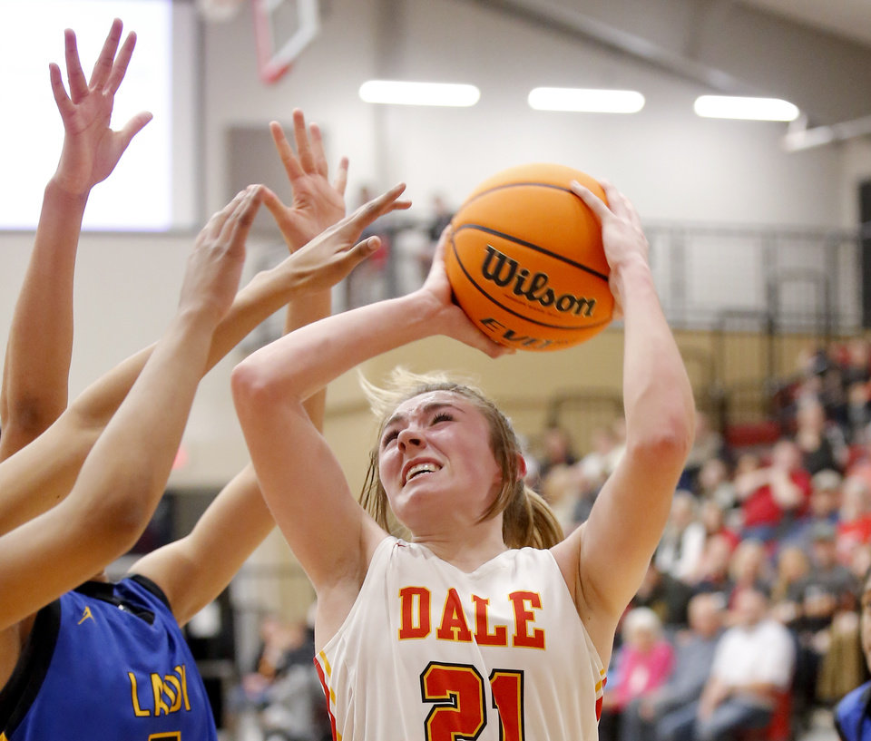 Photo - Dale's Danyn Lang shoots the ball during a home game against Classen SAS on Jan. 14. [Sarah Phipps/The Oklahoman]