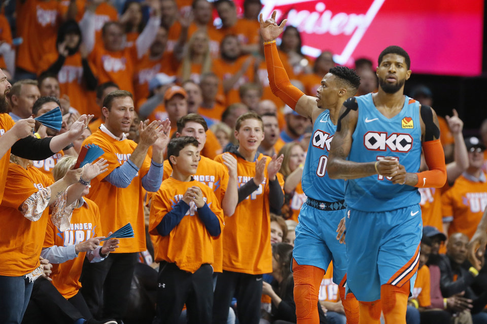 Photo - Oklahoma City's Russell Westbrook (0) gestures to the crowd beside Paul George (13) during Game 3 in the first round of the NBA playoffs between the Portland Trail Blazers and the Oklahoma City Thunder at Chesapeake Energy Arena in Oklahoma City, Friday, April 19, 2019. Oklahoma City won 120-108. Photo by Bryan Terry, The Oklahoman