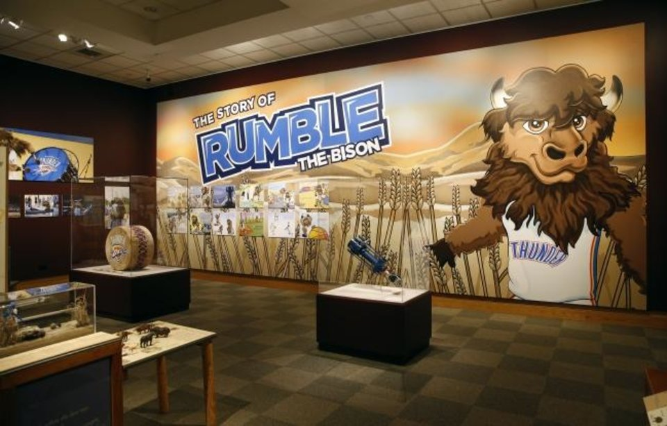 "Photo -  A large mural of Oklahoma City Thunder mascot Rumble the Bison is featured in""Ancient. Massive. Wild – The Bison Exhibit"" at the National Cowboy & Western Heritage Museum in Oklahoma City. [Nate Billings/The Oklahoman]"