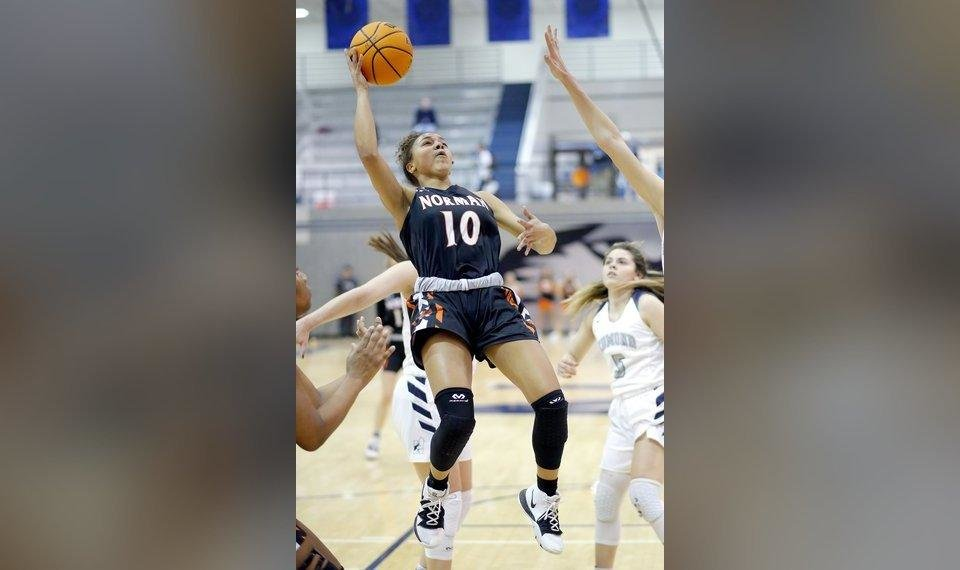 Photo - Norman's Kelbie Washington goes up for a basket during Friday's game at Edmond North. [Sarah Phipps/The Oklahoman]