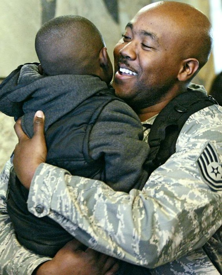 Photo -  MILITARY RETURN: William Hunter hugs his son, William Hunter, Jr., 4, as Hunter and other members of the 507th Air Refueling Wing, U.S. Air Force Reserve, return from duty overseas to Will Rogers World Airport in Oklahoma City on Wednesday, March. 9, 2011. Photo by John Clanton, The Oklahoman   ORG XMIT: KOD