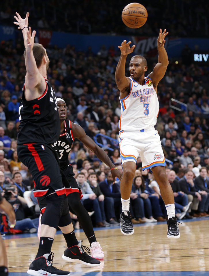 Photo - Oklahoma City's Chris Paul (3) passes away from Toronto's Marc Gasol (33), left, and Pascal Siakam (43) in the second quarter during an NBA basketball between the Oklahoma City Thunder and the Toronto Raptors at Chesapeake Energy Arena in Oklahoma City, Wednesday, Jan. 15, 2020. [Nate Billings/The Oklahoman]
