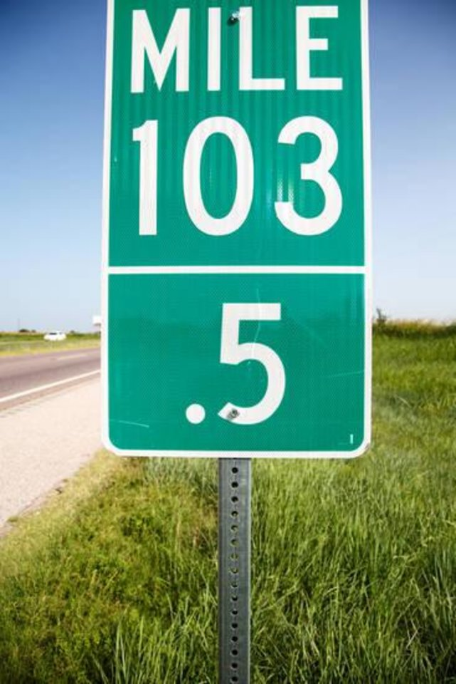 Photo -  New half-mile markers have been added along a section of Interstate 35 in south central Oklahoma. Motorists involved in accidents can use the signs to more precisely describe their locations to emergency reponders. [PHOTO BY ANYA MAGNUSON, THE OKLAHOMAN]