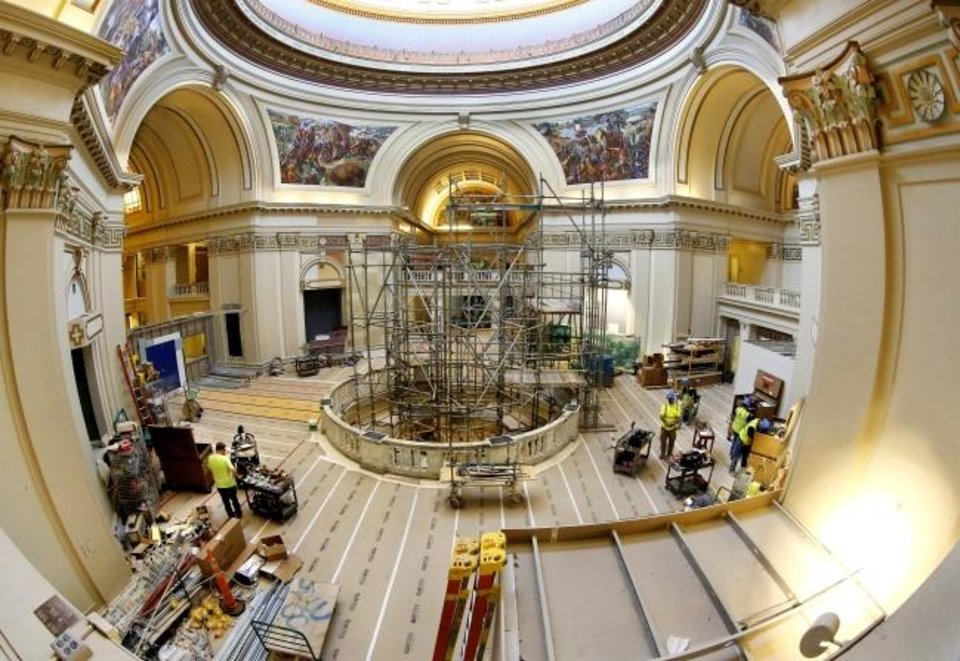 Photo -  Work is being done on the fourth floor rotunda of the Capitol on July 24. [Jim Beckel/The Oklahoman]